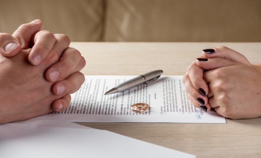 hands on table near two rings