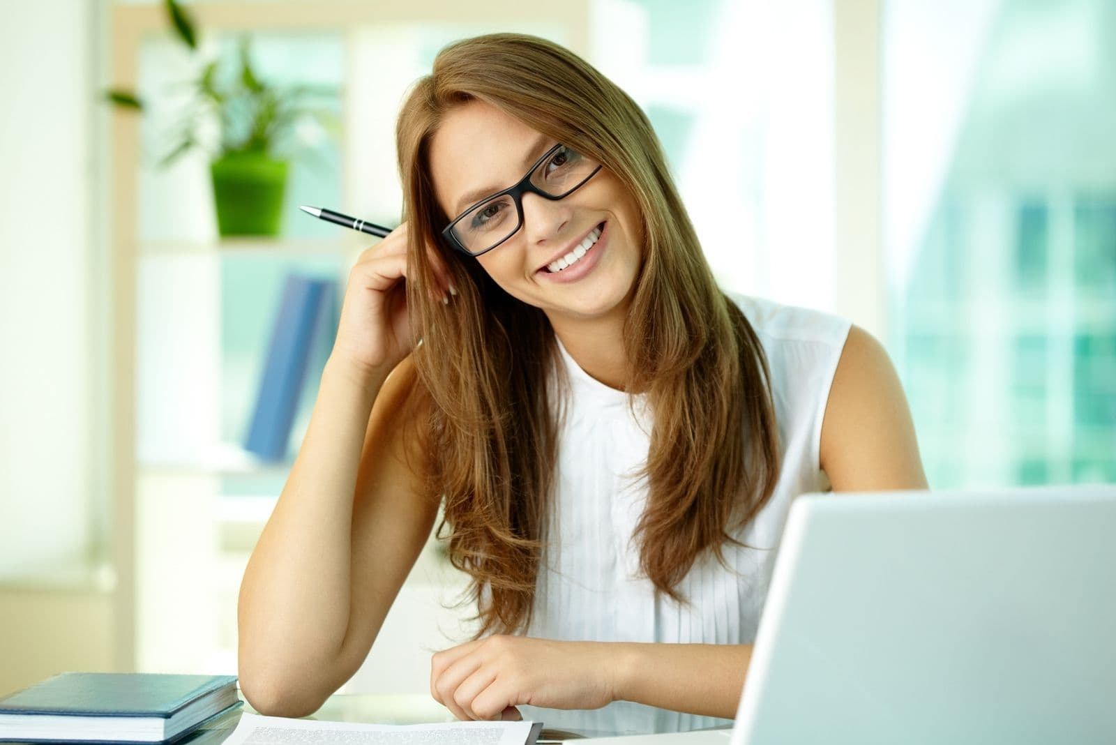 happy business woman smiling inside office by her office table
