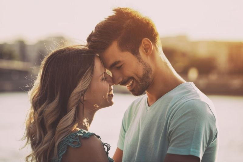 intentionally toned image of a sweet couple standing near the body if water