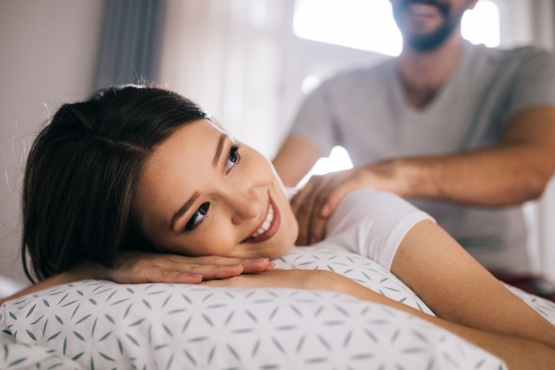 man giving woman a massage at home