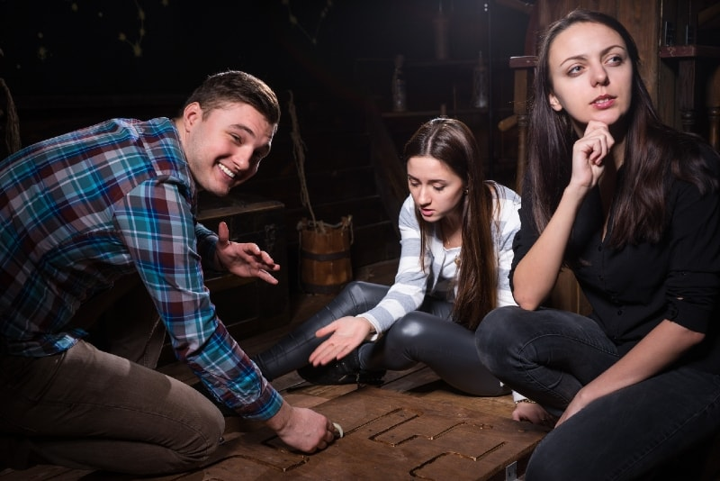 three people thinking while sitting on floor