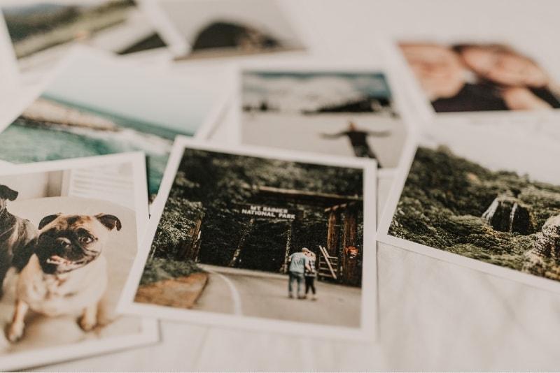several photos on top of white textile