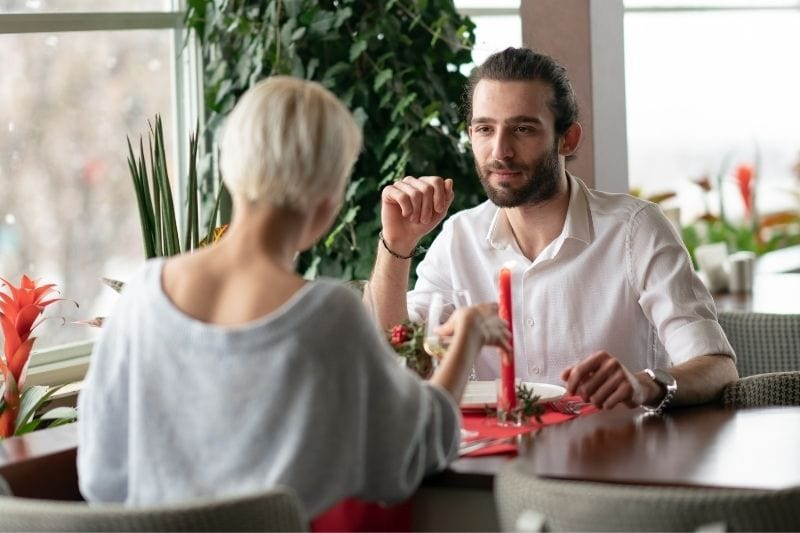 serious couple dating inside a restaurant