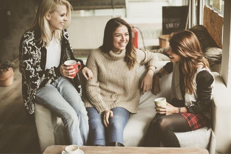 three best friends nejoying conversation and drinking coffee