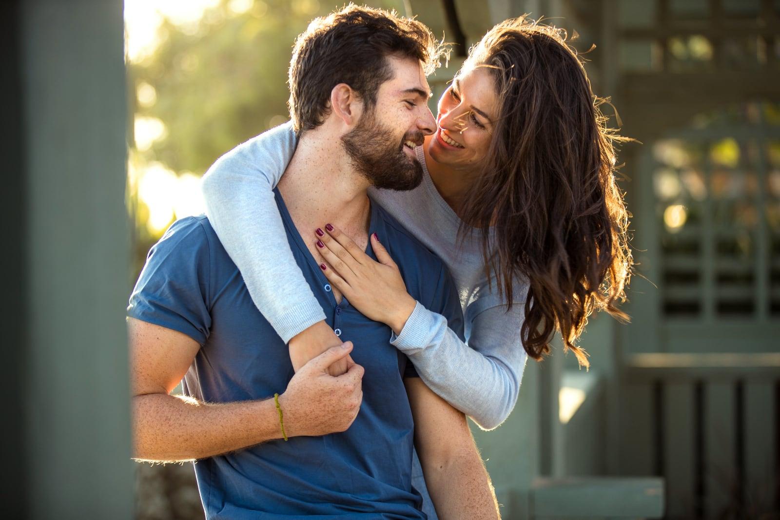 woman hugs man in the park