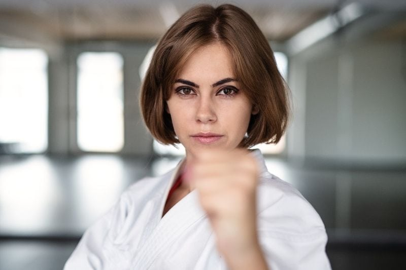 woman practising karate inside the karate gym