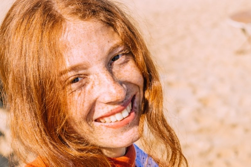 woman with red hair smiling outdoor