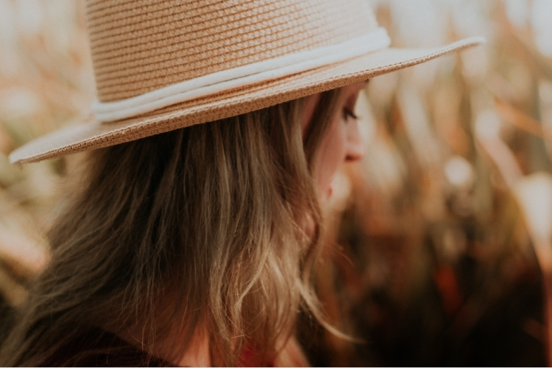 woman with straw hat standing outdoor