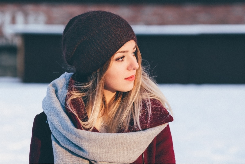 woman with black knit cap standing outdoor
