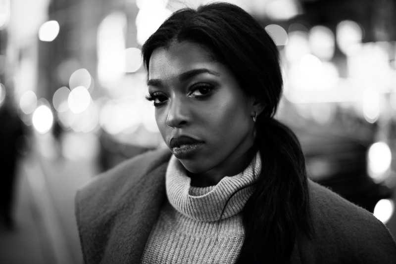 woman in gray turtleneck sweater standing outdoor