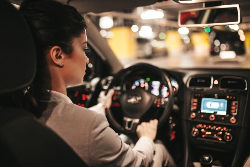 young businesswoman driving her car into the public underground garage