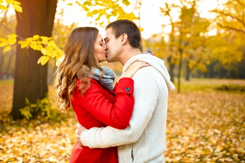 young love couple in the park during autumn season