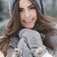portrait of a beautiful brunette outside in winter