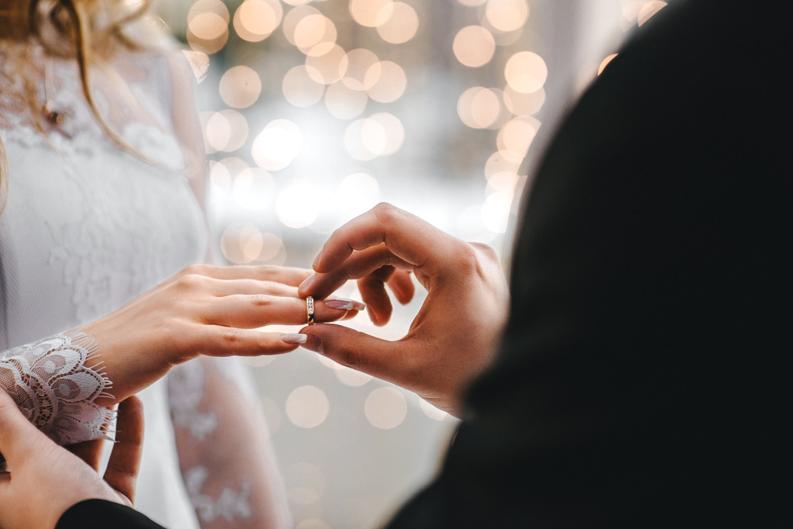 a couple who puts rings on a wedding