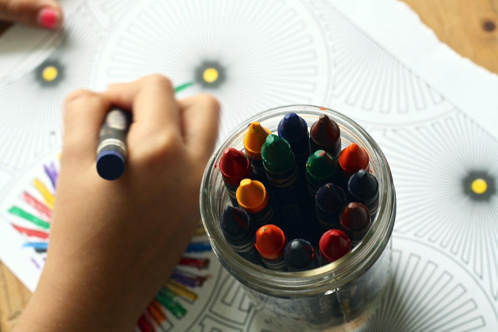 child coloring art with crayon