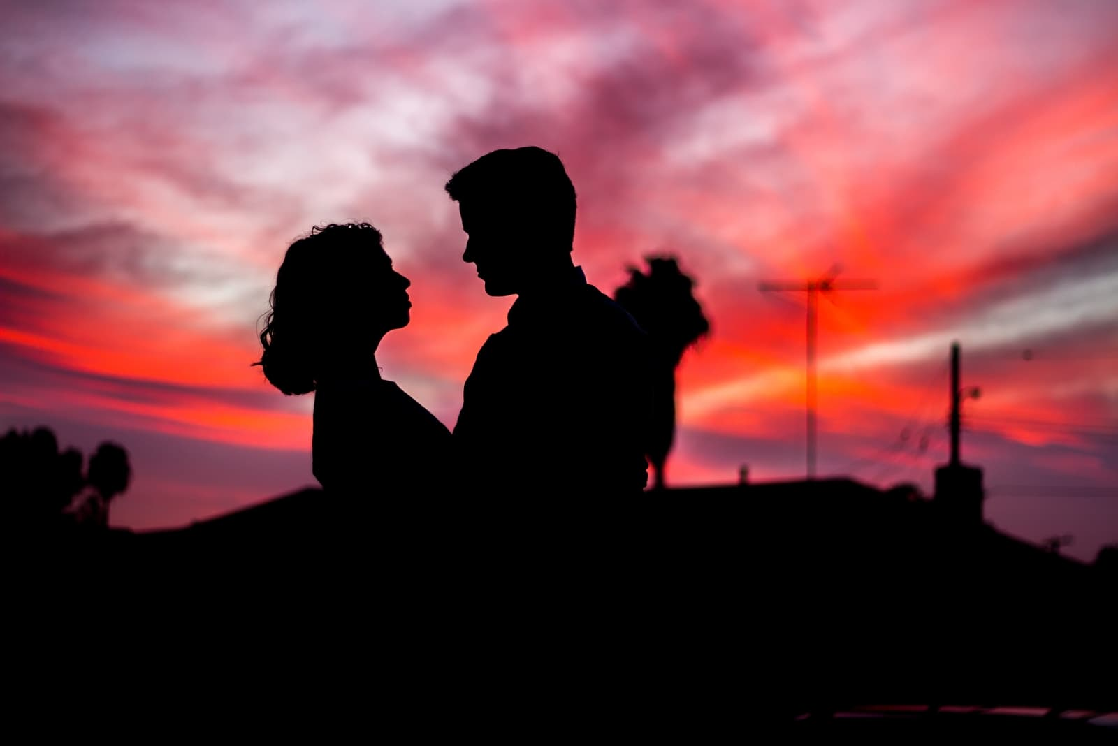 man and woman making eye contact during sunset