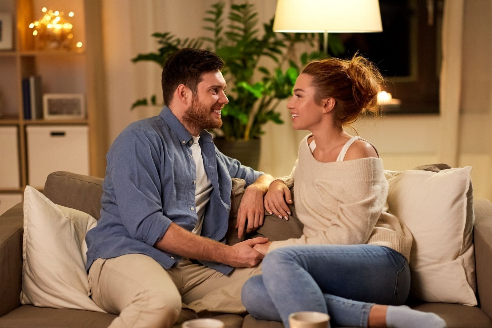 couple talking at home sitting in the couch