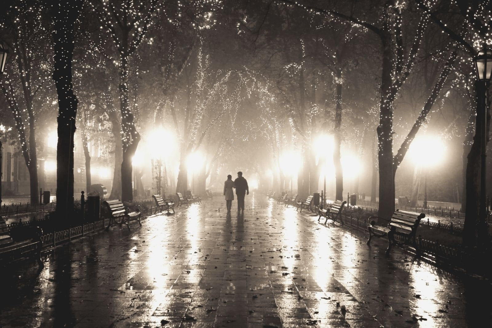 couple walkin at alley in night lights in a distant