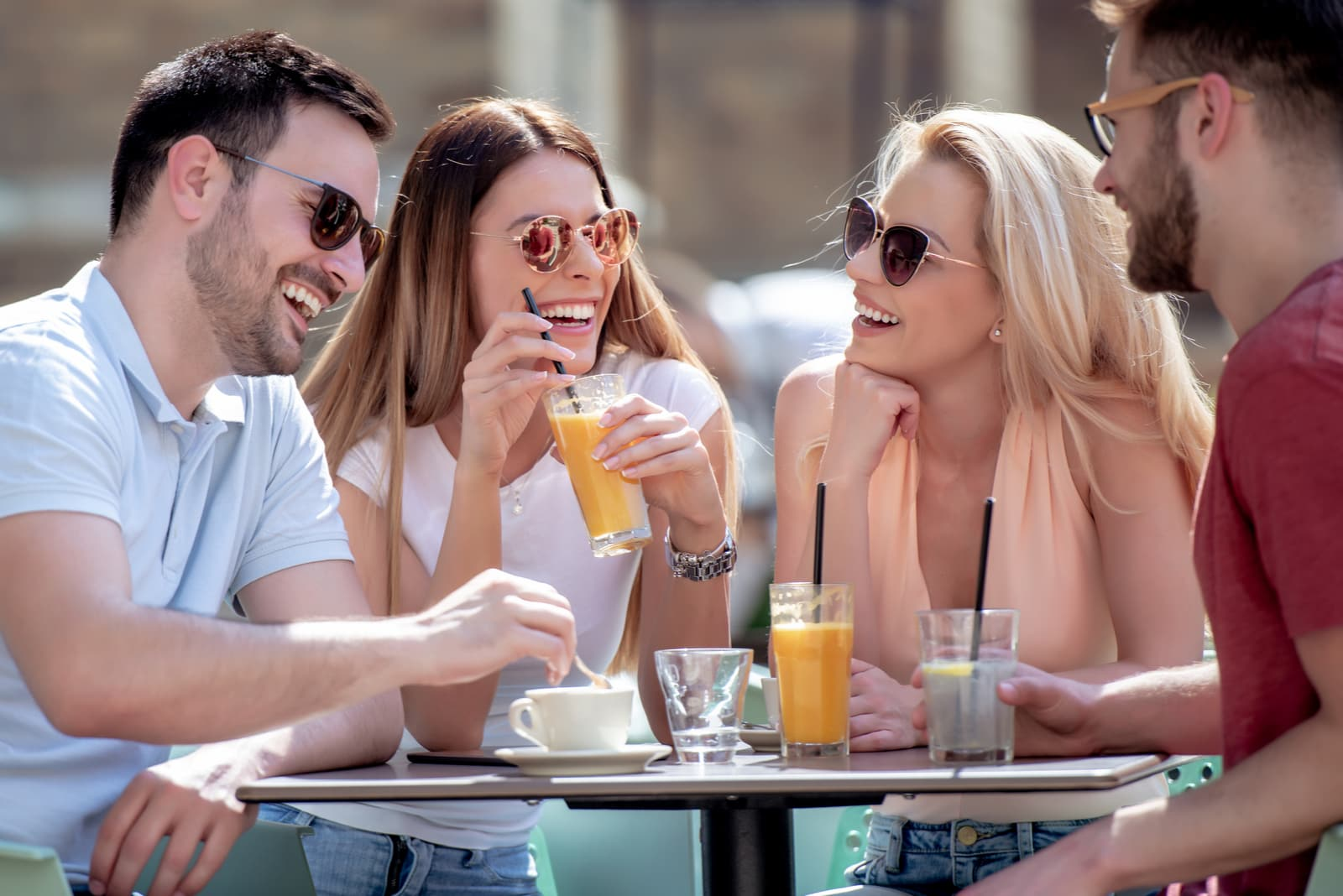 four friends having fun at a coffee shop together