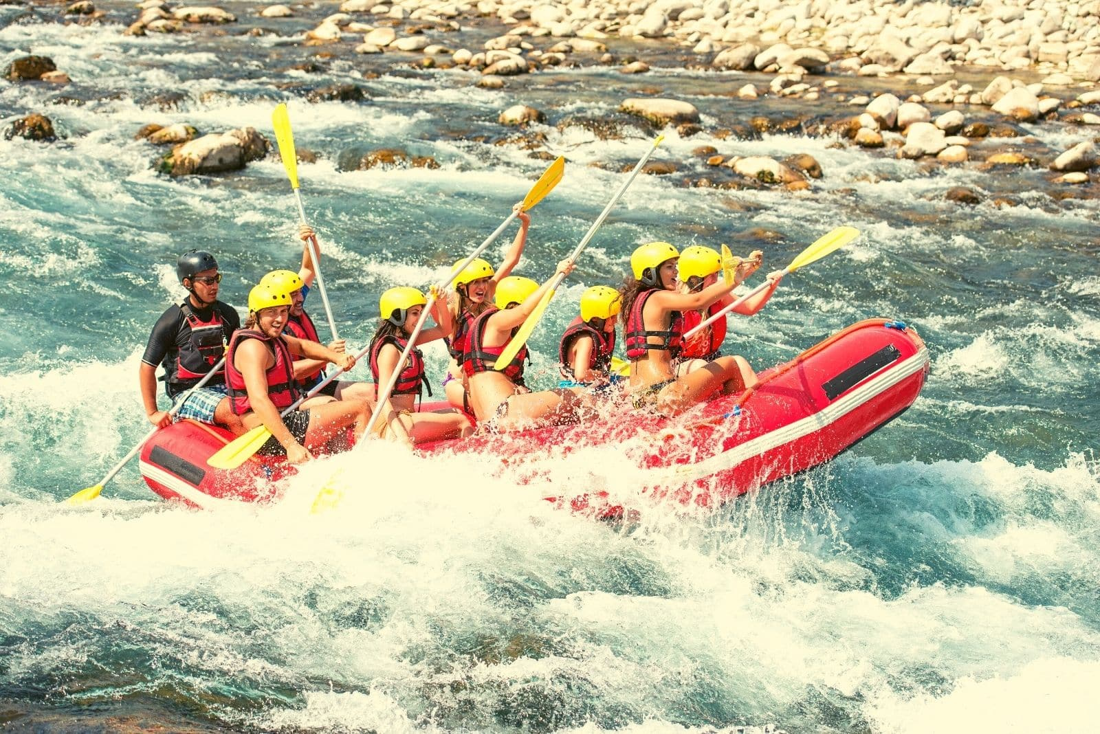 group of people enjoying the white water rafting in the river