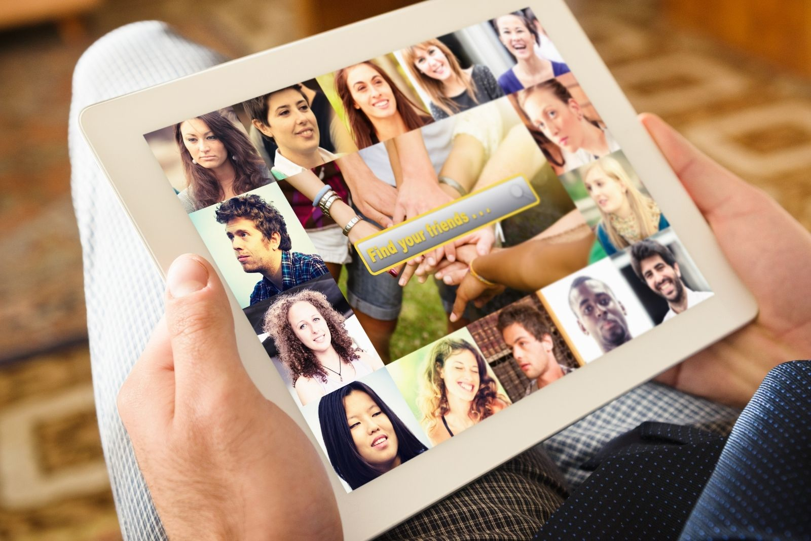 man holding a digital tablet with social media app