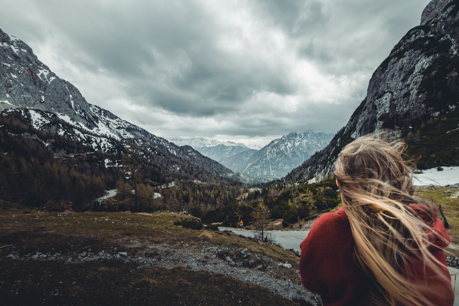 woman in red hoodie looking at mountain