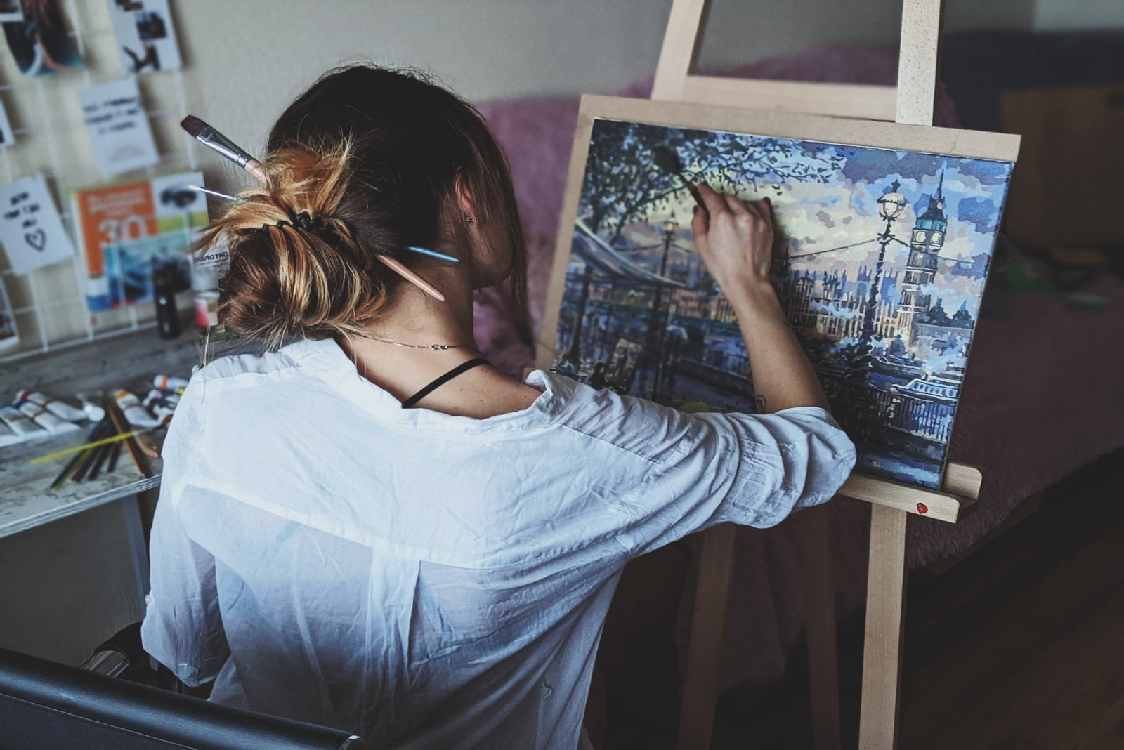 woman in white shirt painting indoor