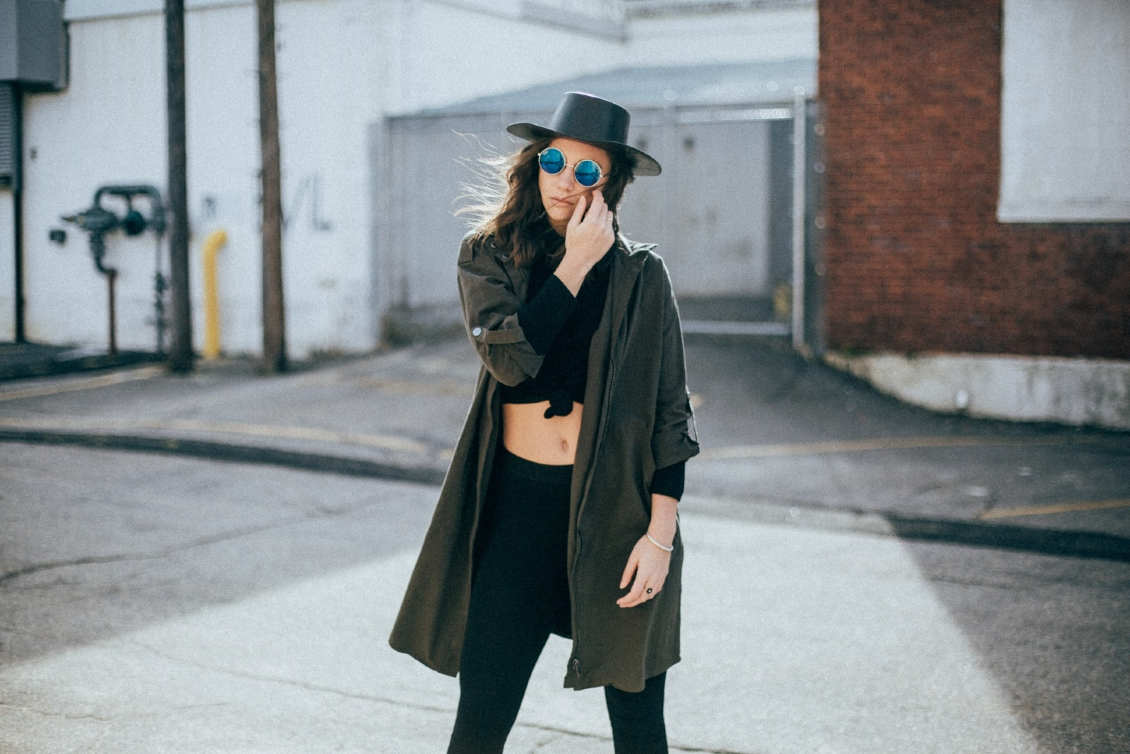 woman with black hat standing outdoor