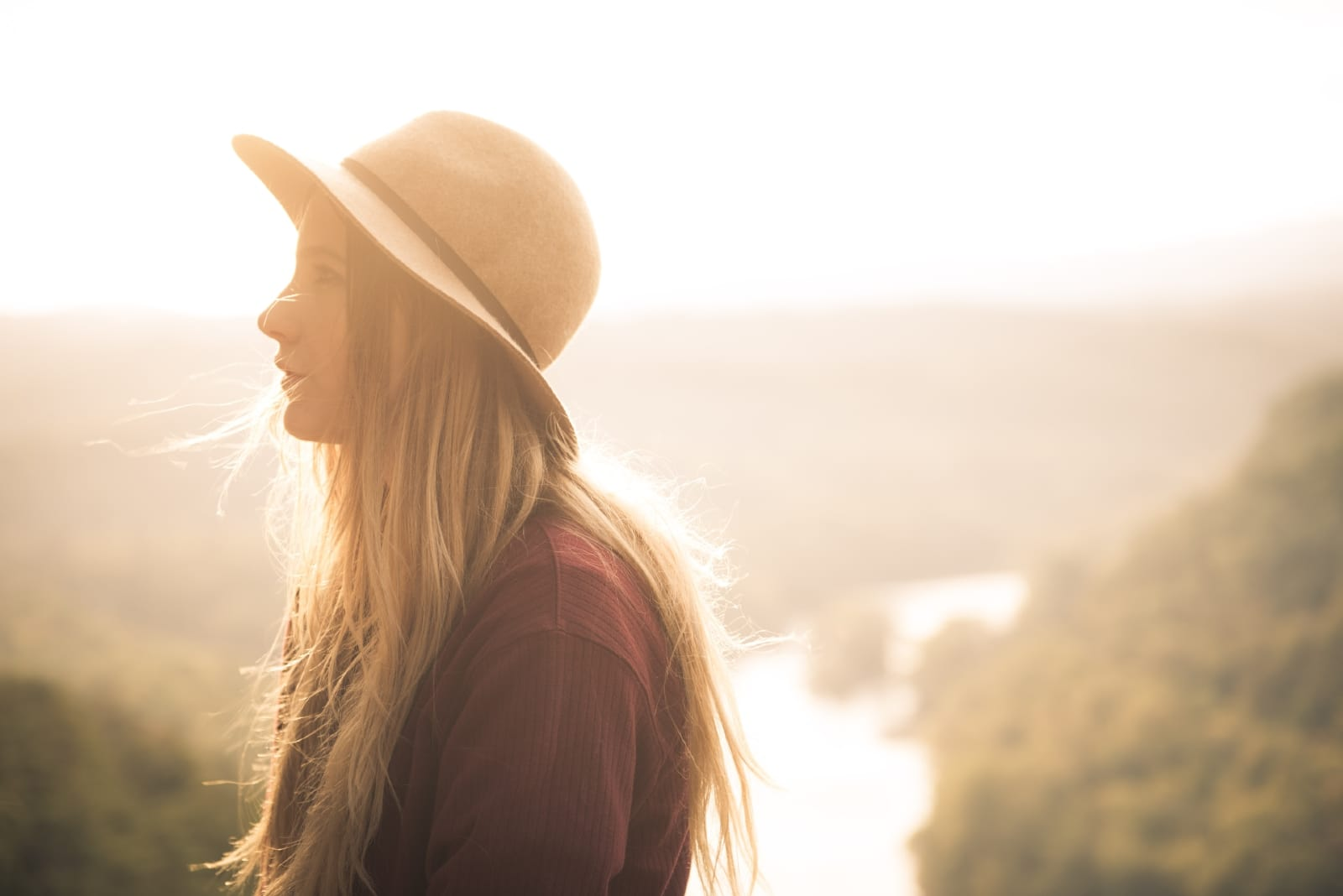 blonde woman with hat standing outdoor