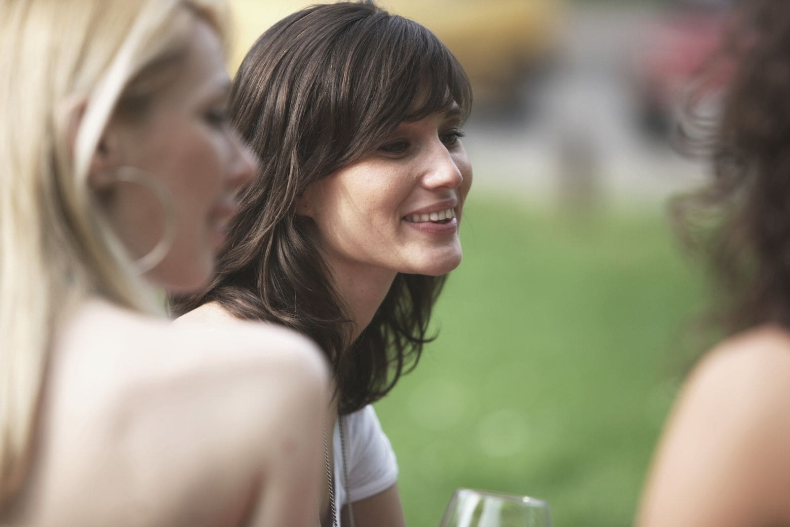 woman with friends enjoying drinking and chatting