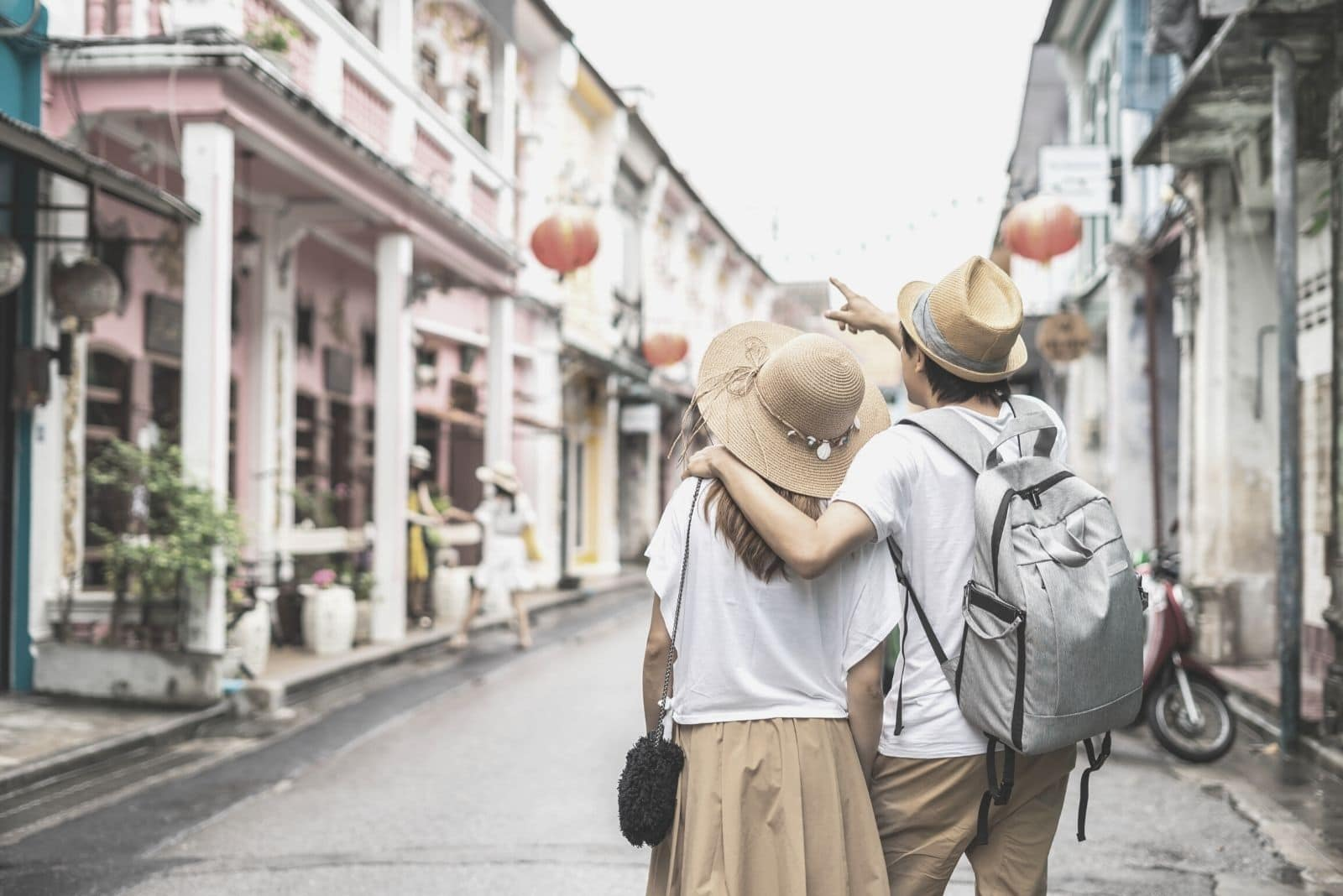 young couple traveller walking at Phuket old town in Thailand