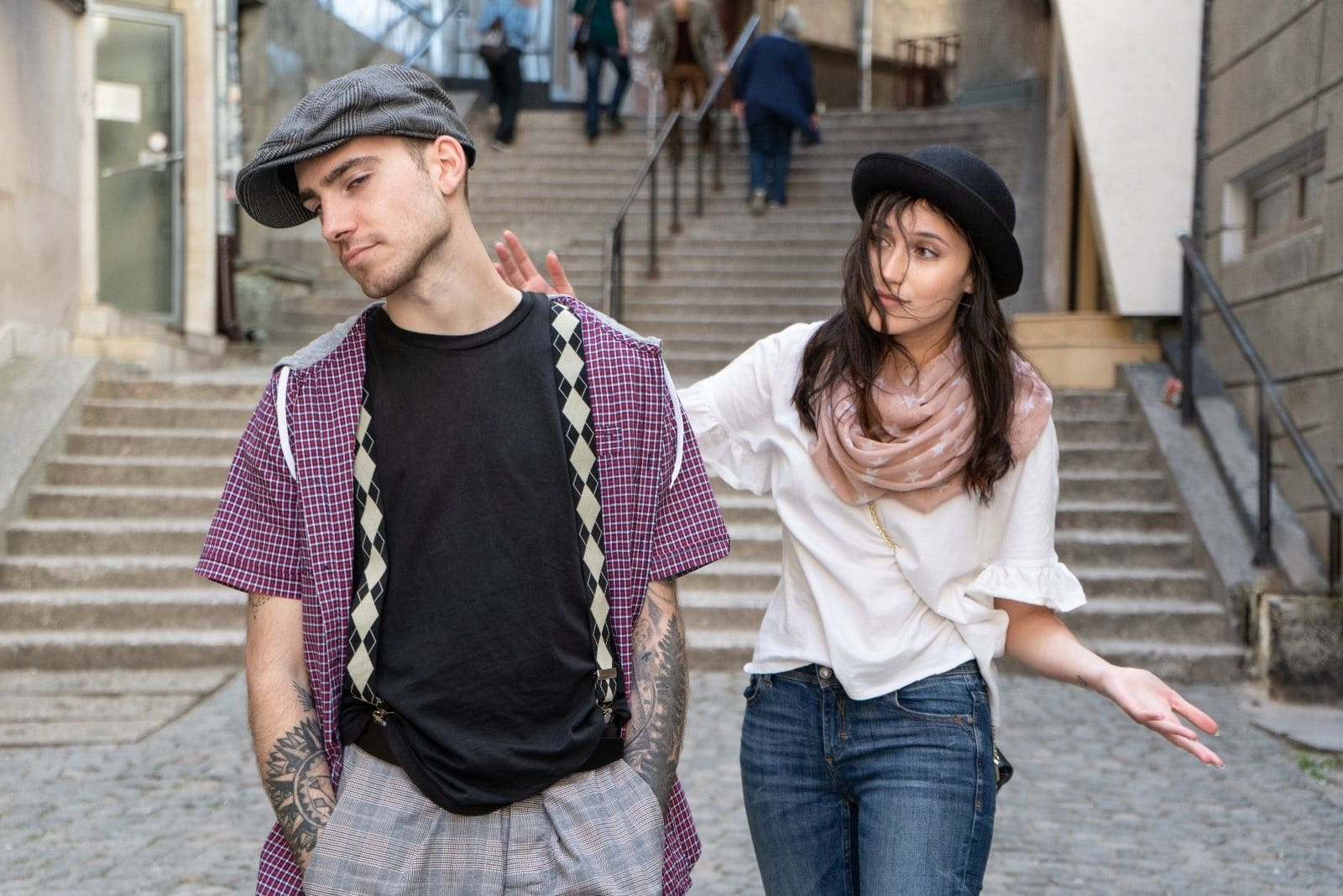 young couple walking in the city arguing or discussing