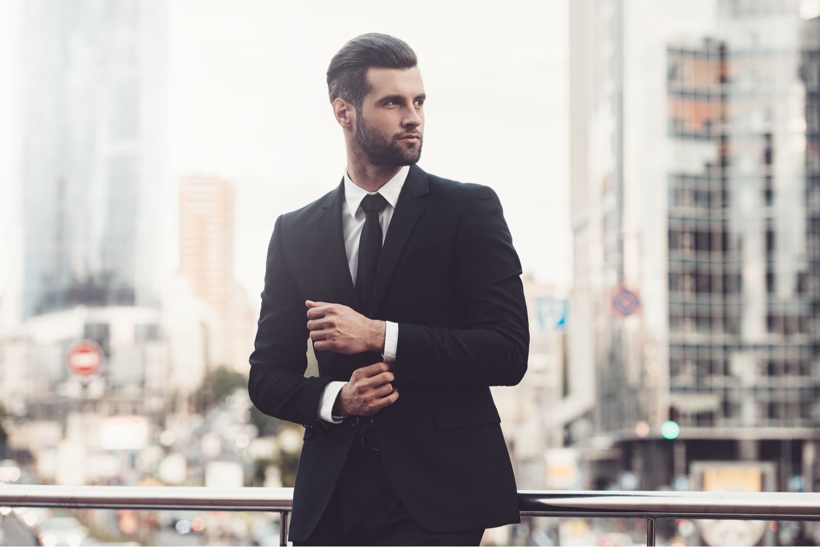 Confident young man in full suit