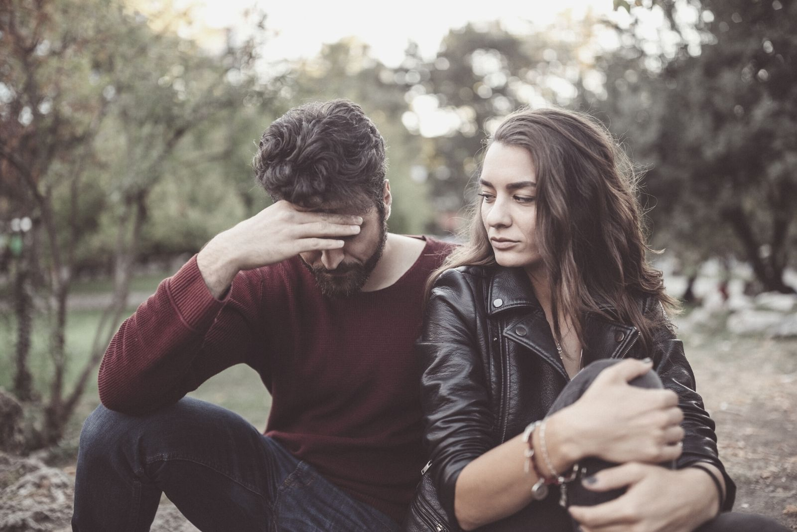 couple breaking up in the park feeling upset