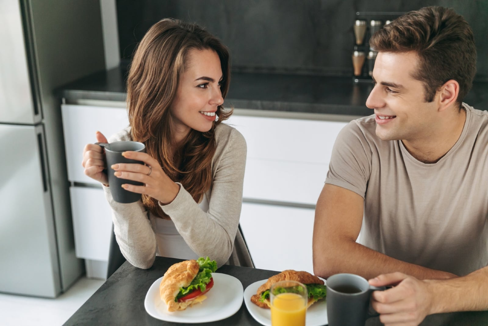man and woman having breakfast at home