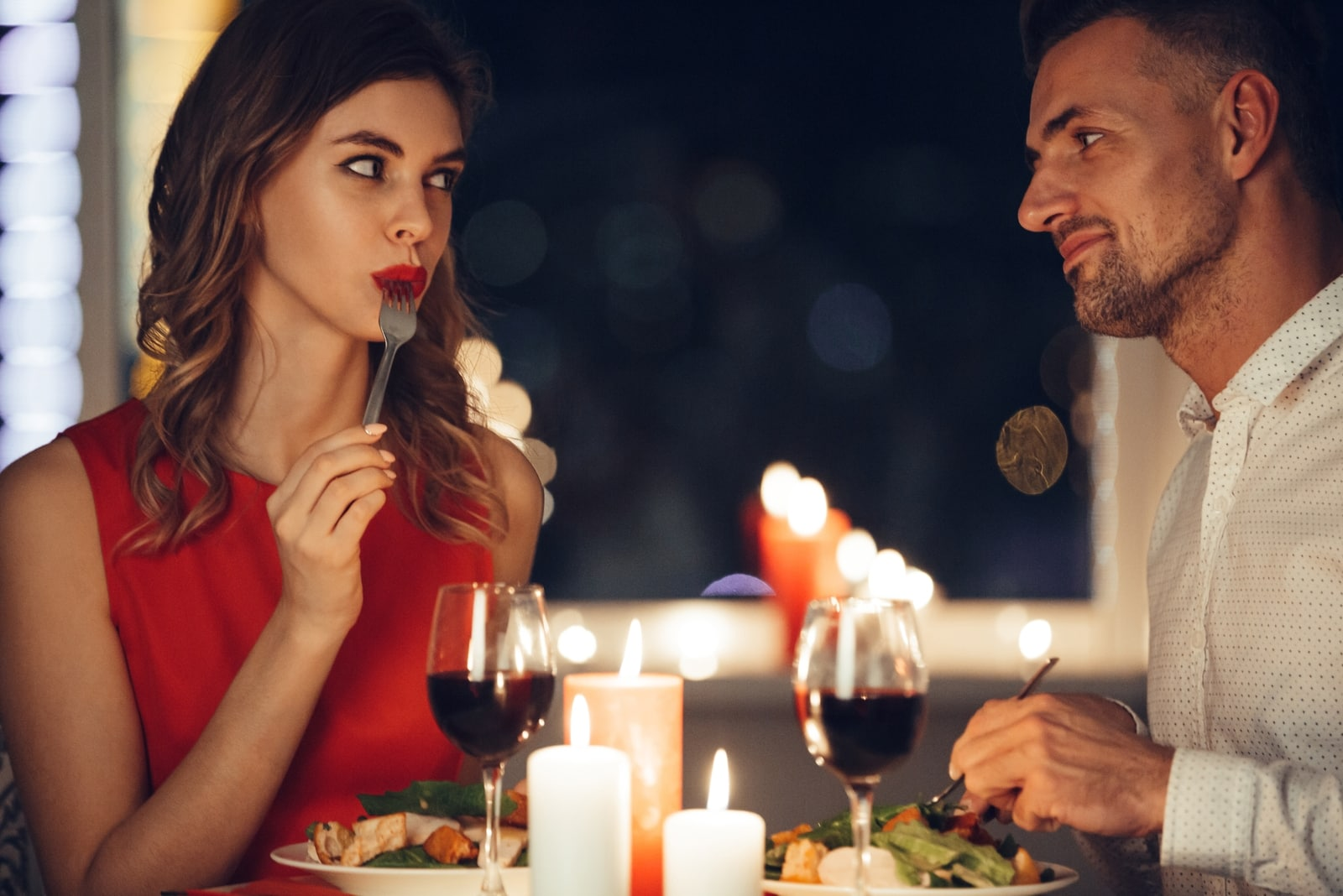 man and woman having dinner at home