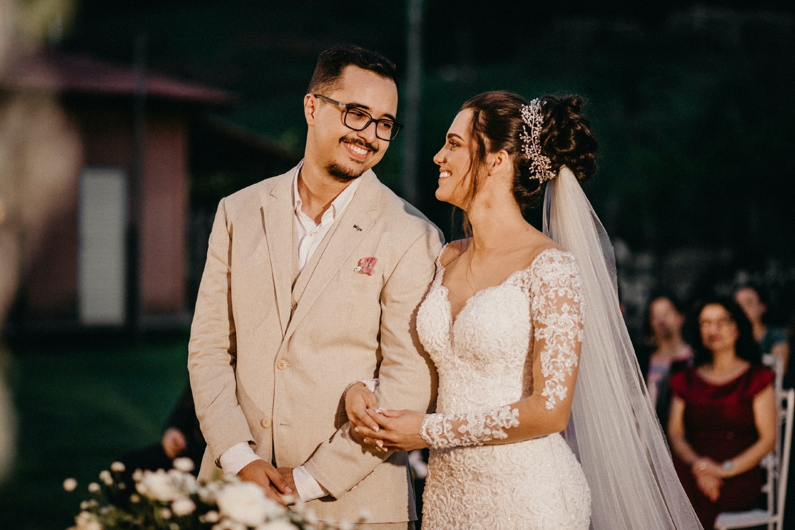 groom and bride making eye contact while standing outdoor