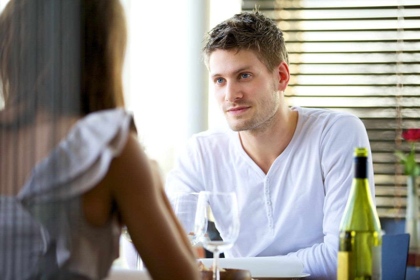 couple seriously conversing in the restaurant during a date