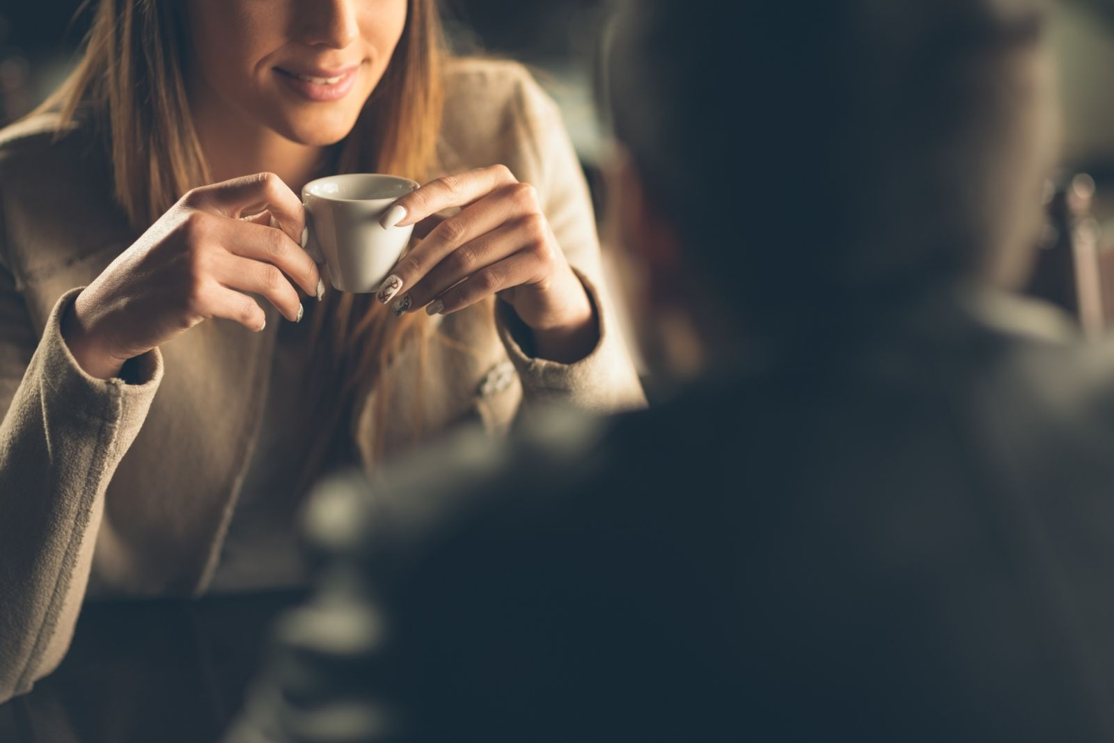 cropped image of a dating couple in coffee bar