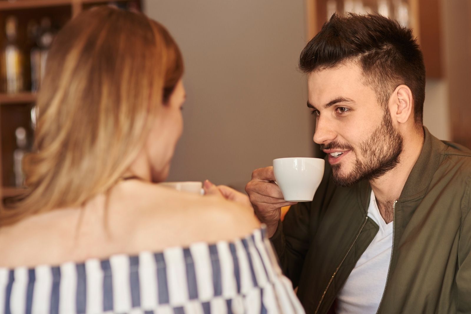 dating couple enjoying coffee and chatting indoors