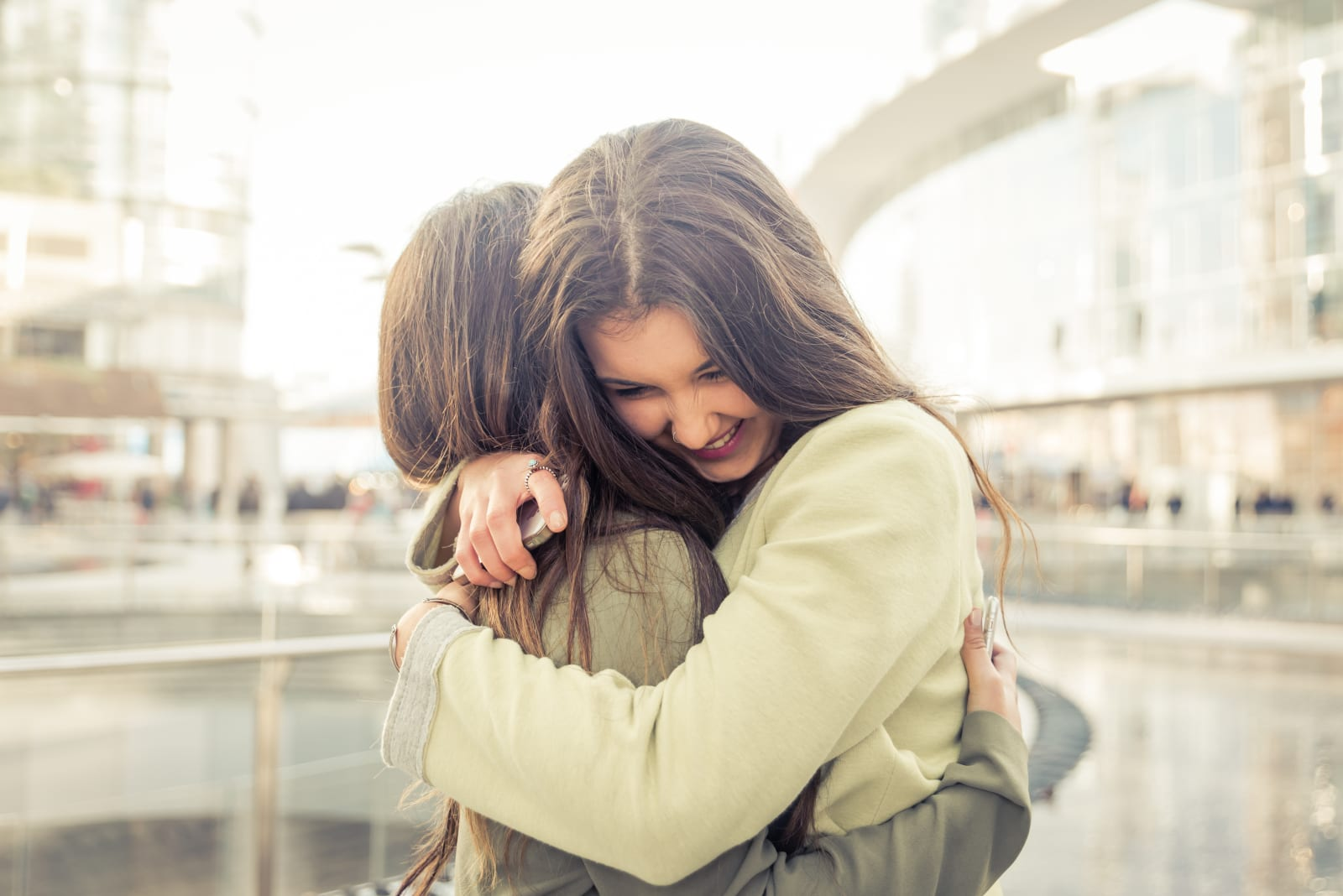 friends hugging after long time