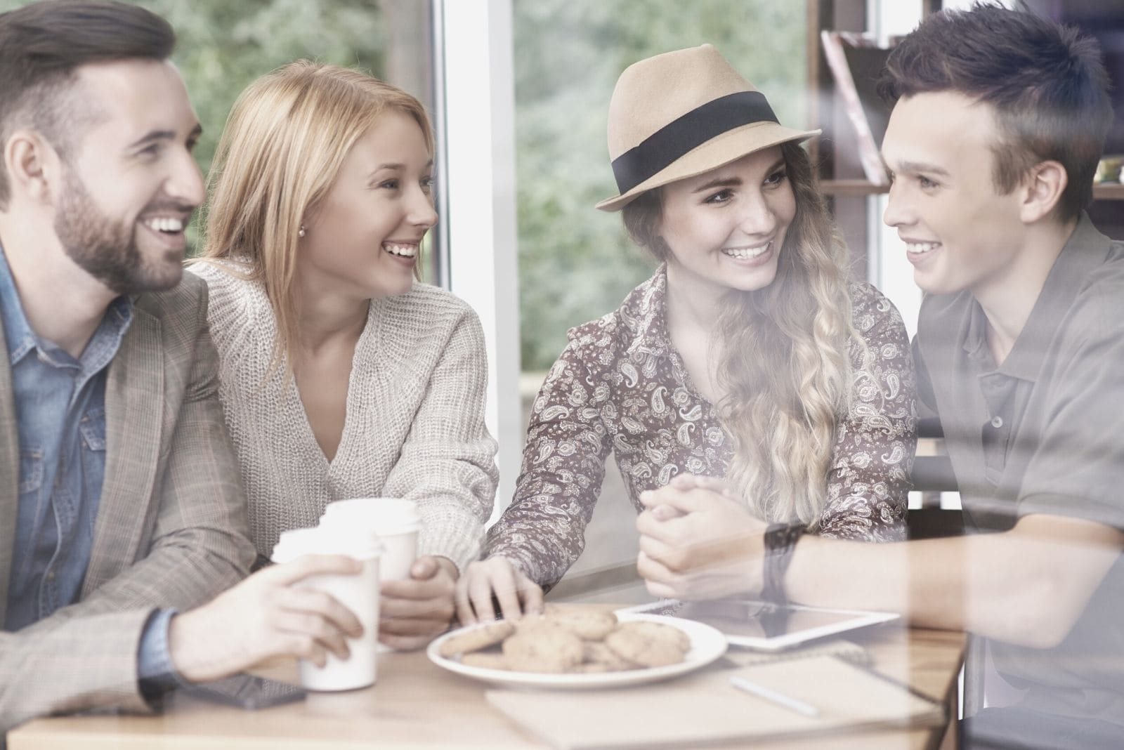group of couple friends having a good chat at a cafe