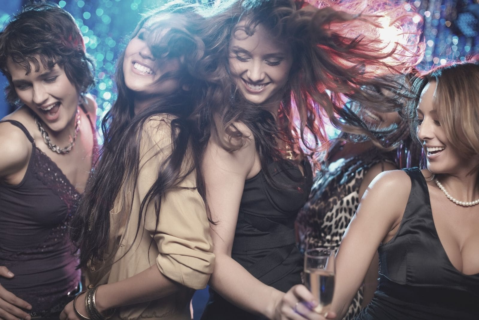 group of sexy woman dancing and drinking in a club party animal concept