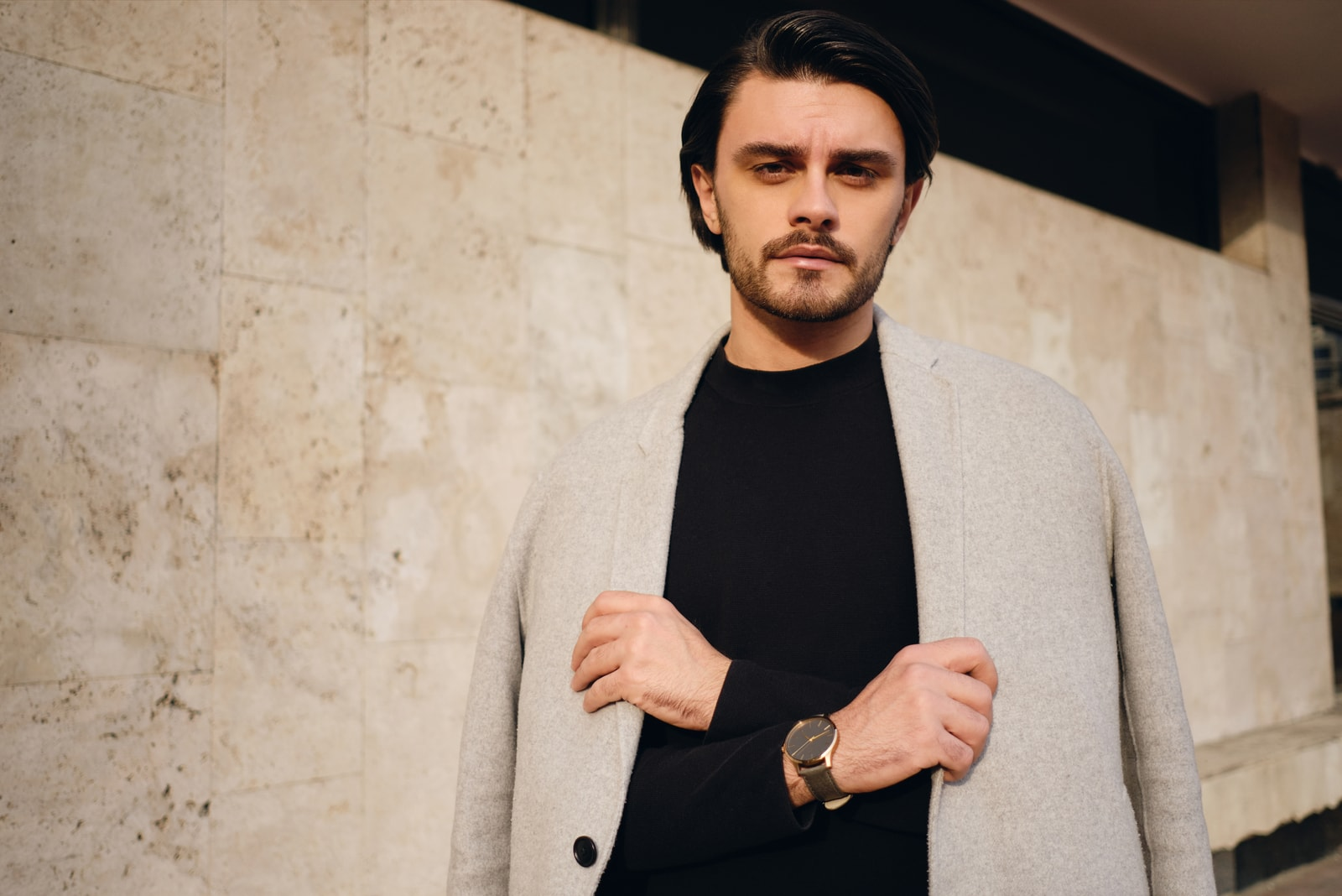 handsome stylish brunette man with coat