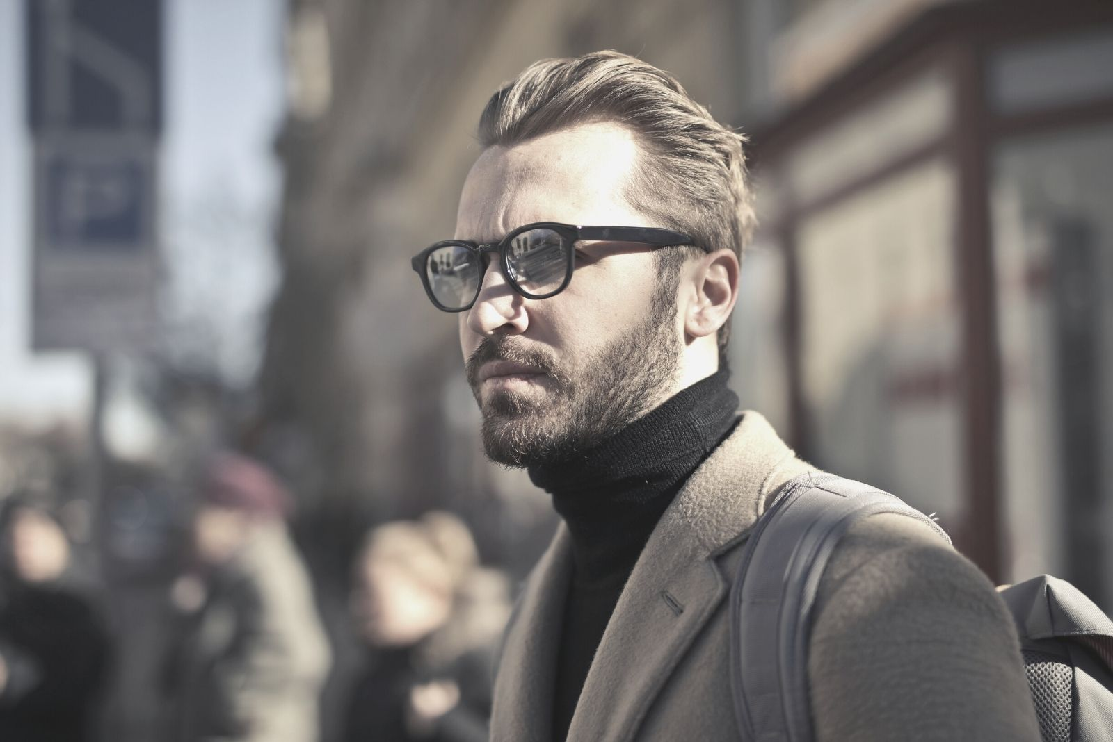 man wearing eyeglasses with suit in fashion standing outdoors