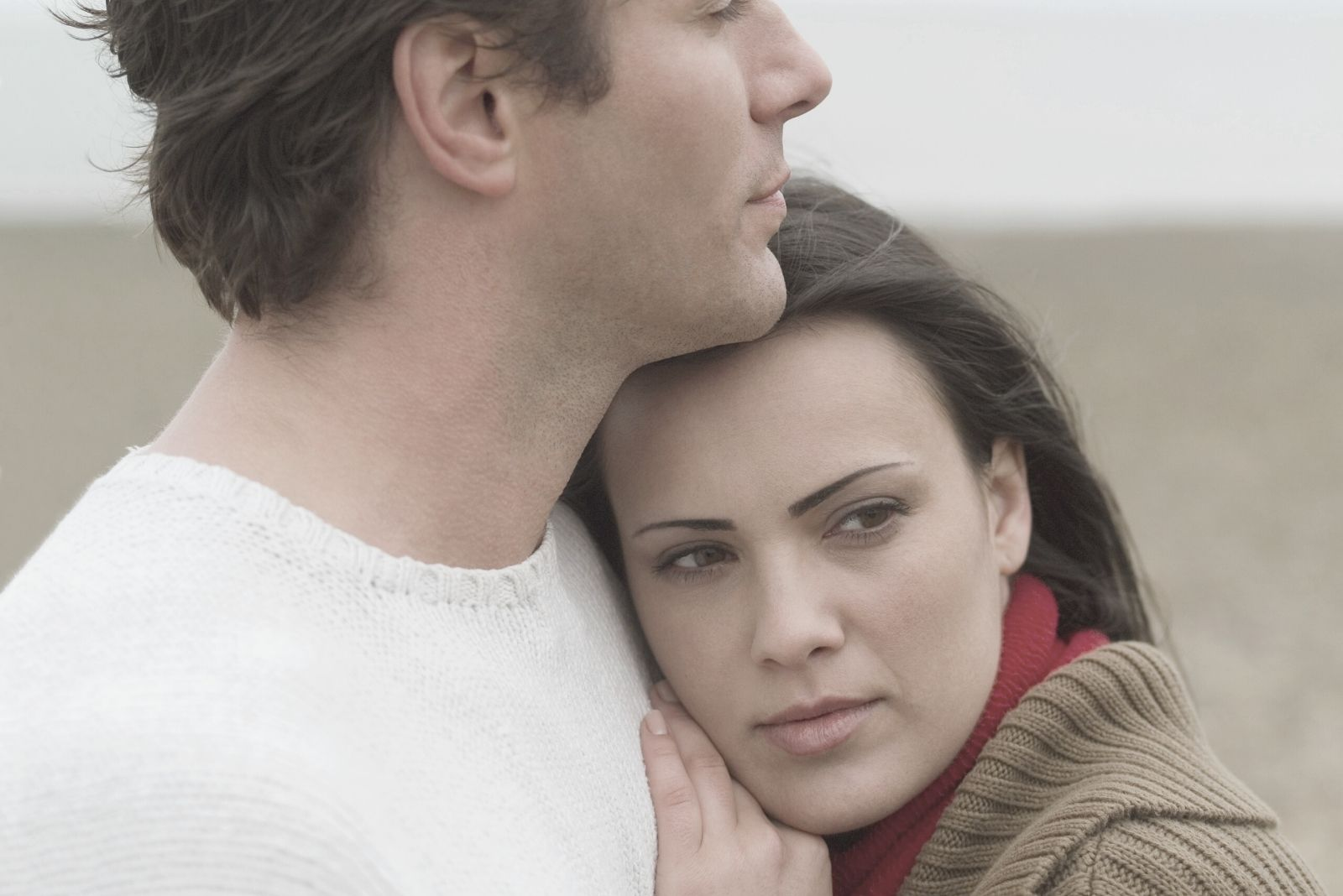 pensive woman hugging and leaning on the handsome man