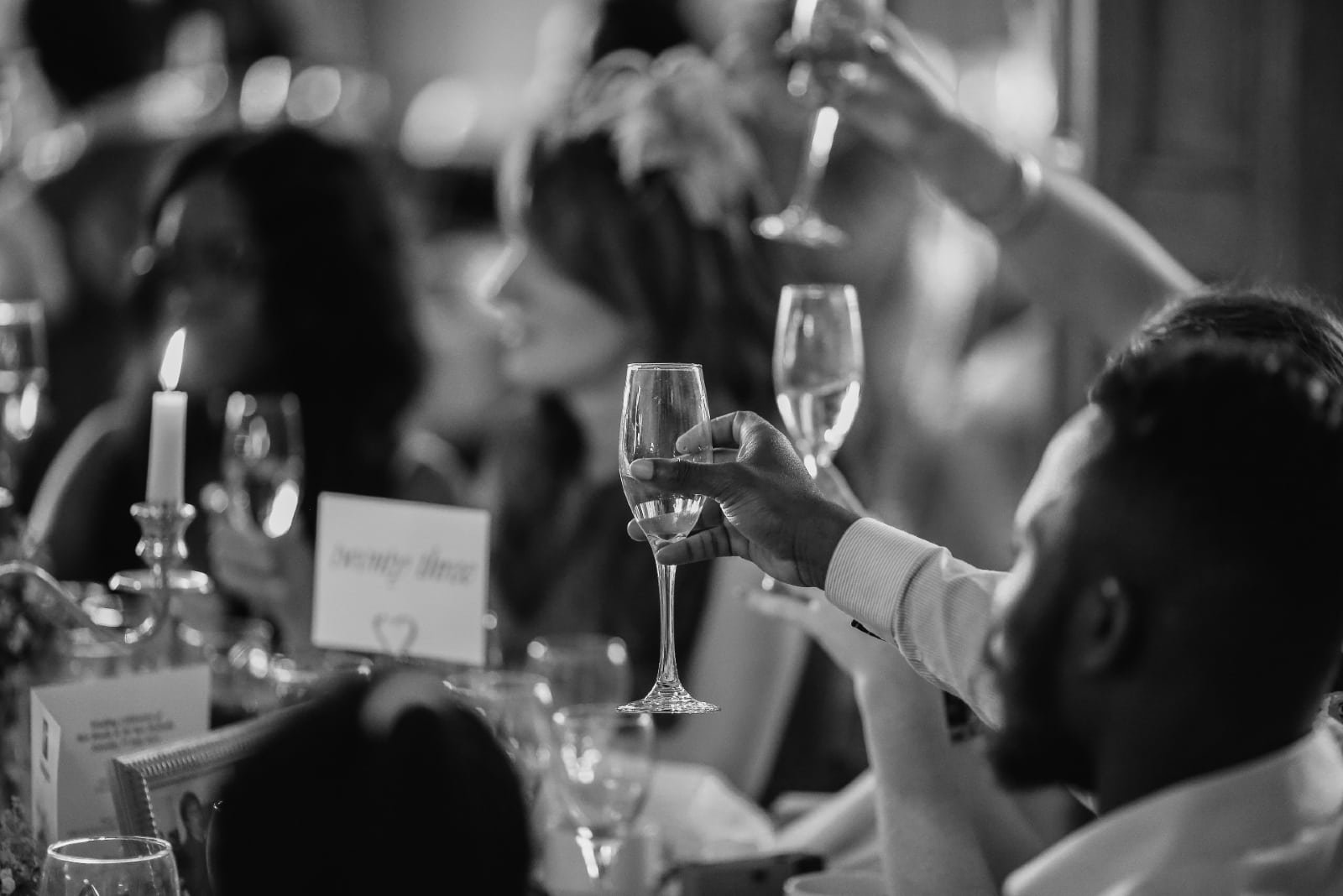 people toasting with champagne while sitting at table