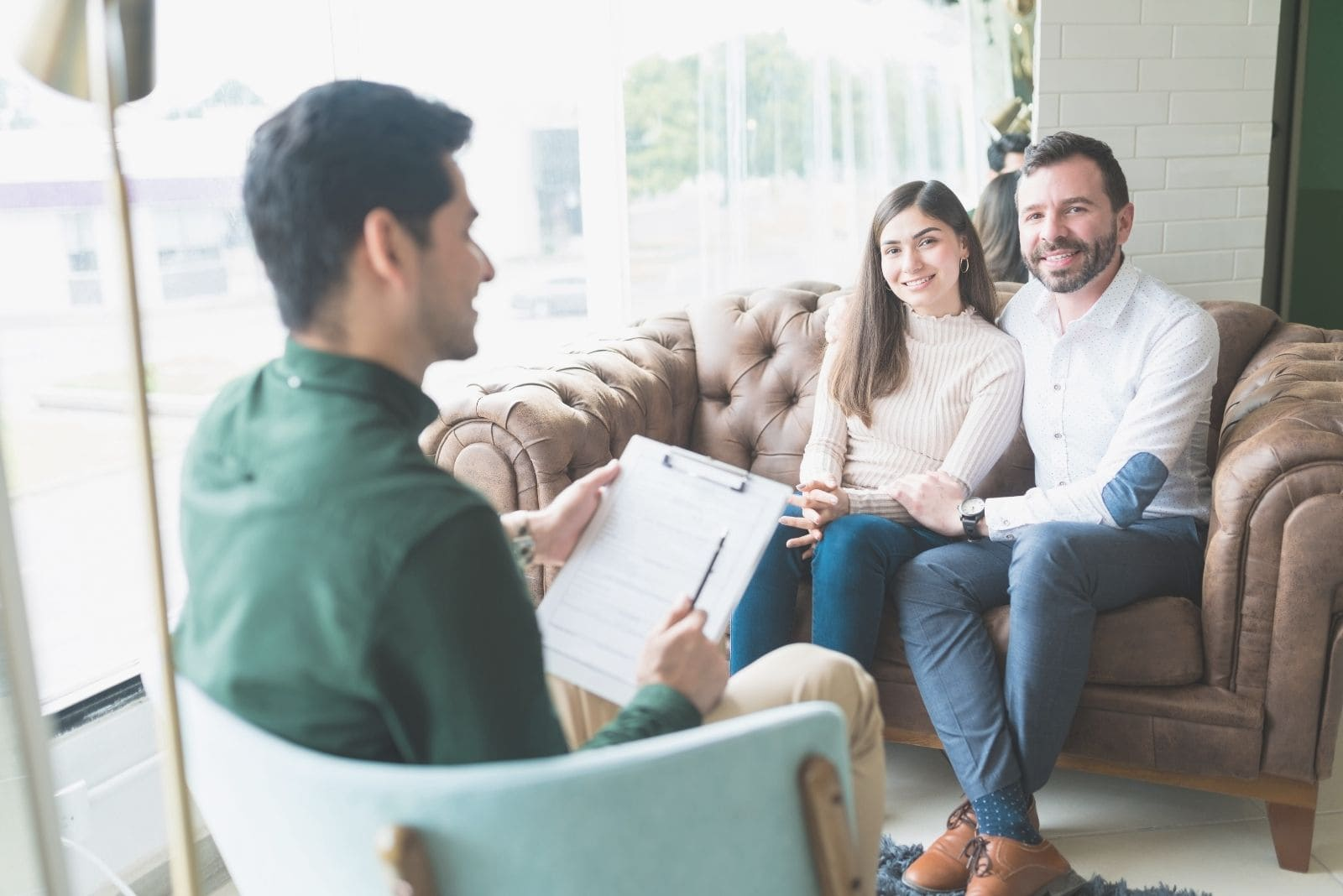 reconciled couple visiting marriage counsellor in a therapy session