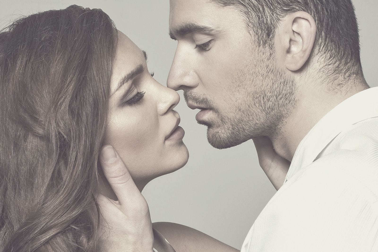 romantic beautiful couple about to kiss passionately in close up photography