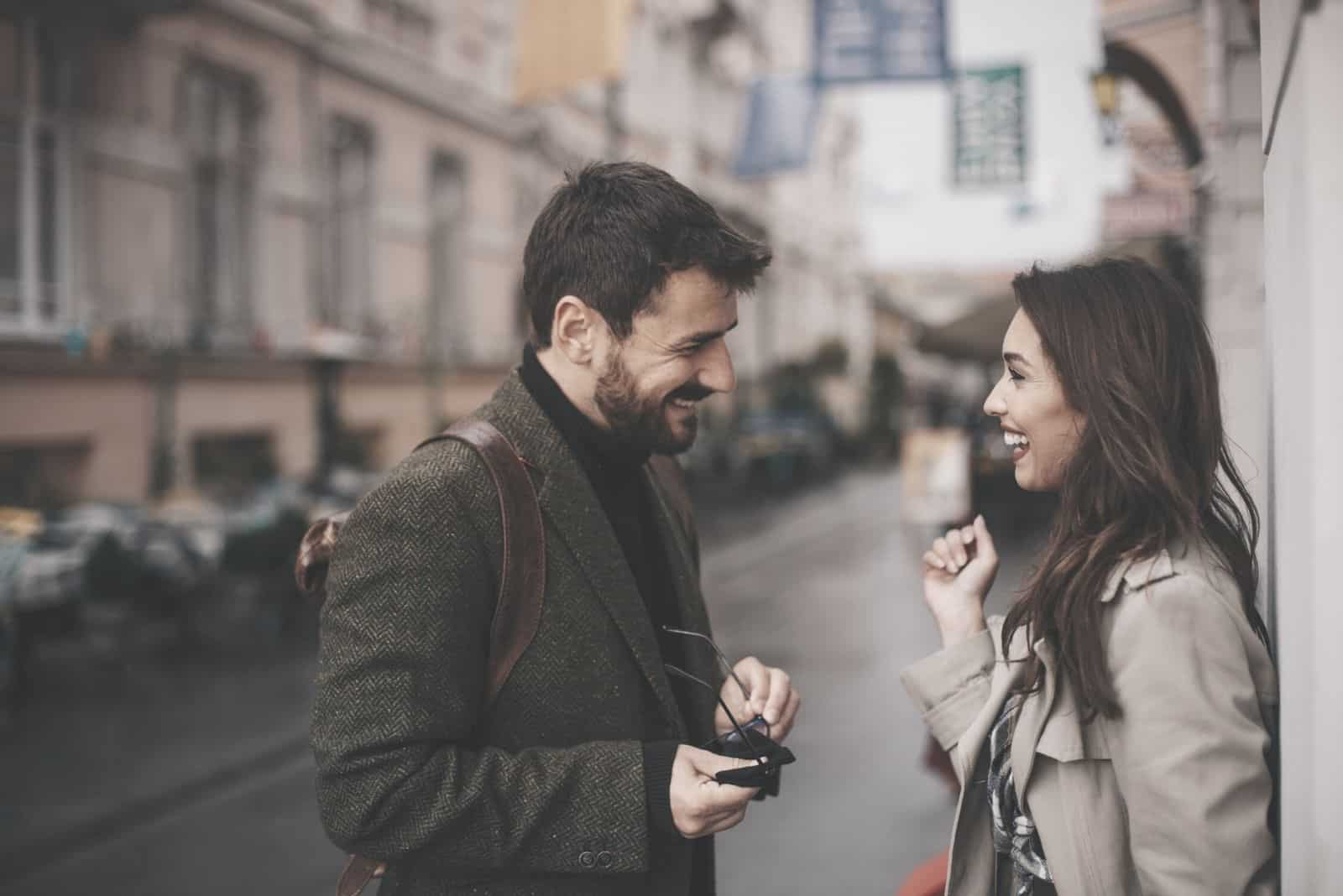 two young hipster having nice conversation on the street with an autumn weather